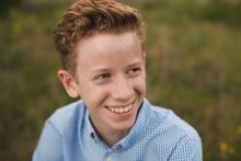 Teenage boy laughing best teen photographer in Dallas Ft Worth by Sunny Mays