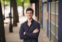 Graduating high school teen photography boy in Dallas Deep Ellum by Sunny Mays Photography