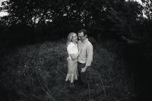 Parents couple in a field by Keller Southlake Westlake Trophy Club family photographer Sunny Mays