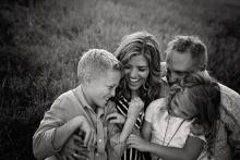 family laughing best Westlake Trophy Club family photographer Sunny Mays