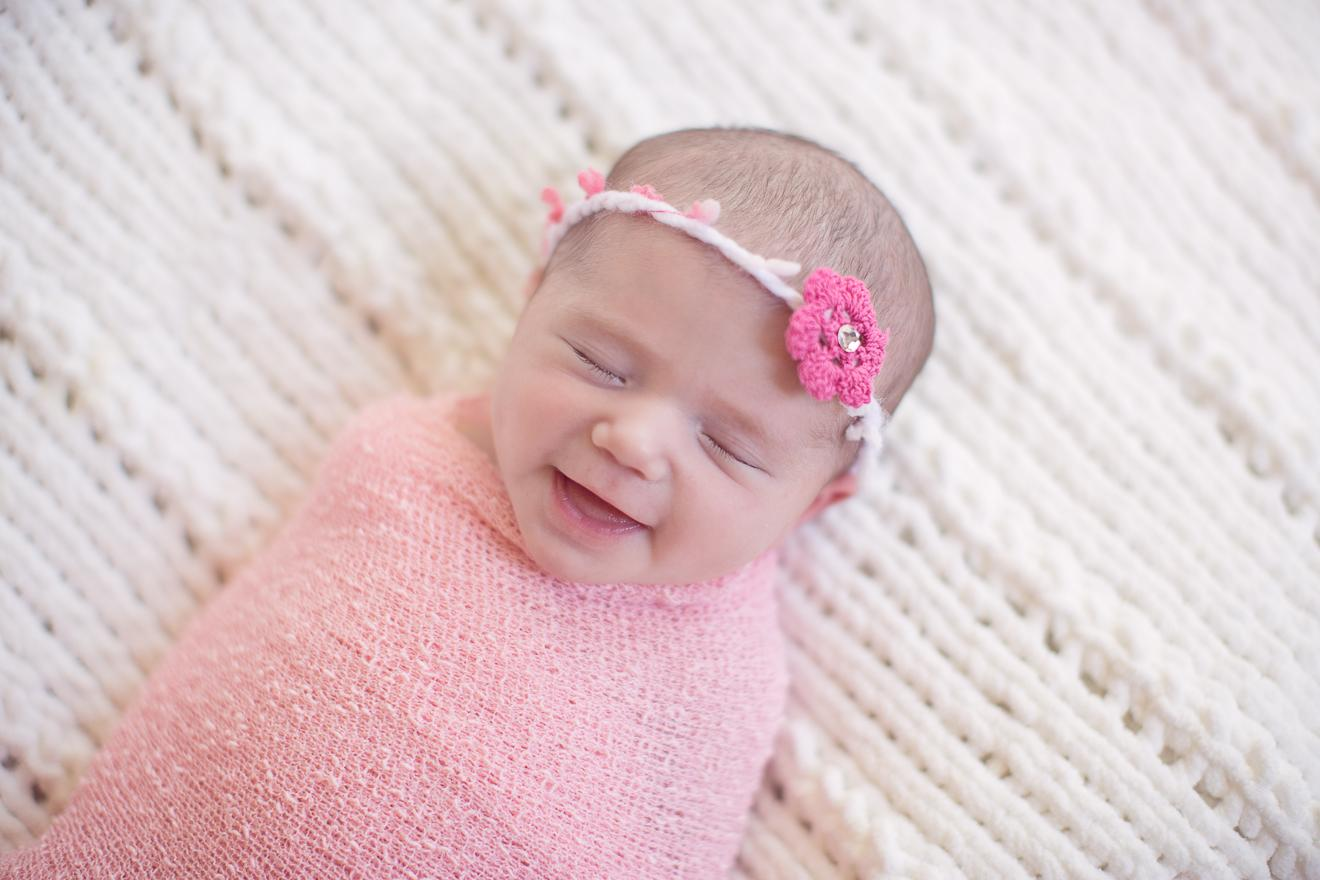 image of smiling newborn baby girl in Ft. Worth Dallas by Sunny Mays Photography