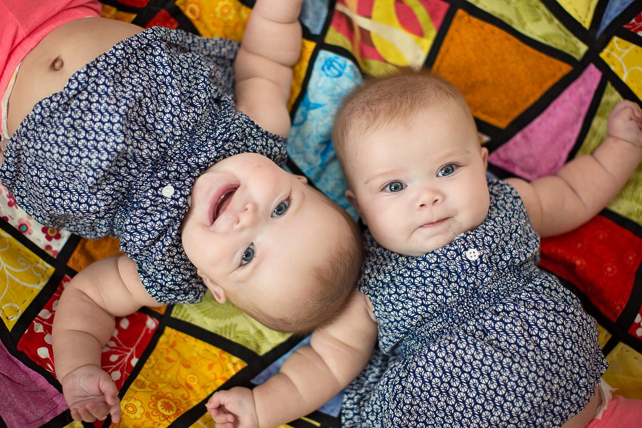 4 four month old twin baby girls by Dallas Ft. Worth best multiples photographer Sunny Mays